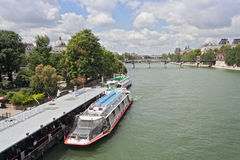 Tourist boat on the river Seine near pont Neuf Royalty Free Stock Images
