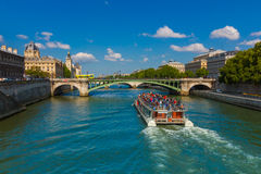 Tourist boat on river Seine in Paris, France Royalty Free Stock Photos