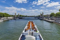 Tourist boat on river Seine by  Pont Alexandre III in Paris, Fra Stock Photography
