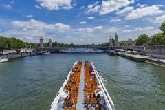 Tourist boat on river Seine by  Pont Alexandre III in Paris, Fra Royalty Free Stock Images