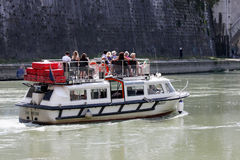 Tourist boat on River Tiber (Rome - Italy) Royalty Free Stock Photos