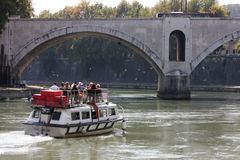 Tourist boat on River Tiber (Rome - Italy) Stock Image