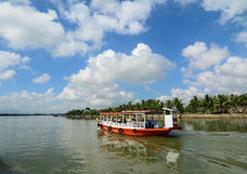 A tourist boat running on river in Hoi An, Vietnam.  royalty free stock images