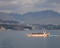 A tourist boat running on the sea. In Hiroshima, Japan stock photos