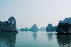 Tourist boat sailing across the famous ha long bay stock photo