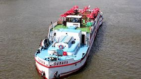 Tourist boat sailing down the river Vltava in central Prague stock video