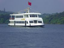 Tourist boat sailing on a lake Royalty Free Stock Photography