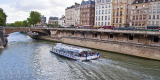 Tourist boat sailing on the Seine Stock Photography