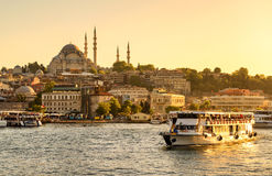 Tourist boat sails on the Golden Horn in Istanbul Royalty Free Stock Photo