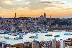 Tourist boat sails on the Golden Horn in Istanbul at sunset, Turkey. Royalty Free Stock Photos
