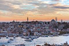 Tourist boat sails on the Golden Horn in Istanbul at sunset, Turkey. Royalty Free Stock Images