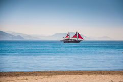 Tourist boat on the sea coast. Stock Image