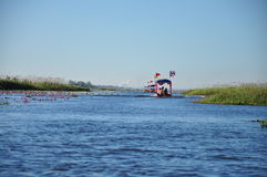 Tourist boat in sparkling water in Harn Lake under blue sky Royalty Free Stock Photography