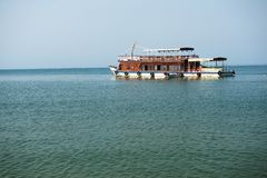 Tourist boat for tours and survey of island Royalty Free Stock Images