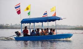 Tourist boat travel for see pink lotus royalty free stock photos