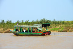 Tourist boat travels along the waterway Stock Images