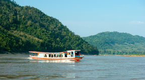 Tourist boat travels on Mekong river. In Laos Royalty Free Stock Images