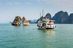 Tourist Boat Visiting the Kissing Rocks in Halong Bay, Vietnam Royalty Free Stock Photo