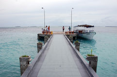 Tourist boat and visitors at concrete pier Maldives Stock Photos