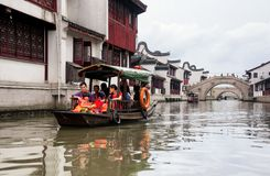 Zhaojialou Water Town Shanghai China. A tourist boat on the water canals of Zhaojialou in Shanghai China on an overcast day royalty free stock photo