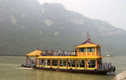 Tourist  boat in Yangtze river. Yellow tourist  boat with lots of people in Yangtze river at the three gorges beauty spot.Taken in Yichang city of Hubei province Stock Photos