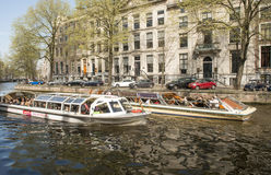 Tourist boats in Amsterdam Royalty Free Stock Photography