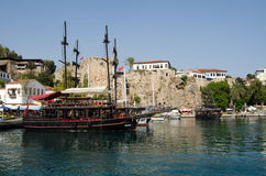 Tourist boats, Antalya Harbour. ANTALYA, TURKEY  AUGUST 18, 2014:  Pirate ships designed to take tourists on trips along the Mediterranean coast moored at the Stock Photography