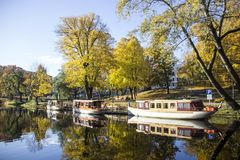 tourist boats Autumn park in the center of Riga, Latvia Canal that flows through Bastion park autumn Stock Images