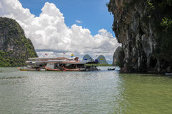 The Tourist Boats on the Bay near Karst Islands Stock Photos