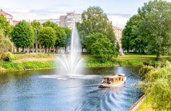 Tourist boats on a cruise in Riga canal, Latvia Stock Photo