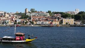 Tourist boats on the Douro river at Ribeira, historical center of Porto stock footage