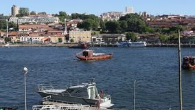 Tourist boats on the Douro river at Ribeira, historical center of Porto stock video footage