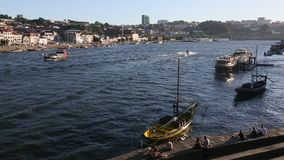 Tourist boats on the Douro river at Ribeira, historical center of Porto. stock footage