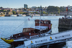 Tourist boats on the Douro river at Ribeira, historical center of Porto. Stock Photos