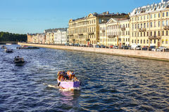 Tourist boats on Fontanka river in Saint Petersburg. Saint Petersburg, Russia. Tourist in boats. Sightseeing Royalty Free Stock Images
