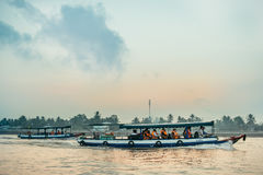Tourist boats going on sunrise on Mekong river Royalty Free Stock Image