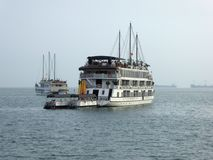 Tourist boats in halong bay Vietnam Stock Photos