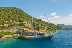 Tourist boats at an island with old church ruins Royalty Free Stock Photos