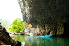 Tourist boats, the mouth of Phong Nha cave with underground river, Phong Nha-Ke Bang National Park, Vietnam.  Stock Photos