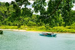 Tourist boats, the mouth of Phong Nha cave with underground river, Phong Nha-Ke Bang National Park, Vietnam Royalty Free Stock Photography