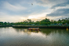 Tourist boats moving on the Nhieu Loc canal. Ho Chi Minh, Vietnam - June 14, 2016: Tourist boats moving on the Nhieu Loc canal at Saigon. The tour is designed to Stock Images