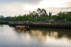 Tourist boats moving on the Nhieu Loc canal. Ho Chi Minh, Vietnam - June 14, 2016: Tourist boats moving on the Nhieu Loc canal at Saigon. The tour is designed to Stock Image