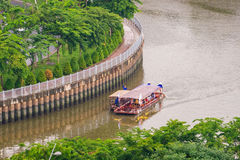 Tourist boats moving on the Nhieu Loc canal. Ho Chi Minh, Vietnam - June 14, 2016: Tourist boats moving on the Nhieu Loc canal at Saigon. The tour is designed to Royalty Free Stock Photos