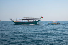 Dhow tourist Boats in musandam  with life boat Royalty Free Stock Photos