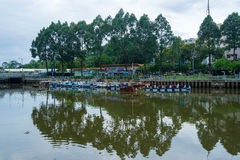 Tourist boats parking at wharf at downtown of Saigon. Ho Chi Minh, Vietnam - June 11, 2016: Tourist boats moving on the Nhieu Loc canal at Saigon. The tour is Royalty Free Stock Photos