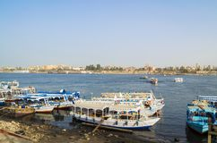 Tourist boats at the pier on the east bank of the Nile, Egypt stock photography