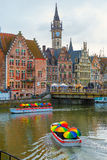 Tourist boats in rainy day on river Leie, Ghent Stock Photography