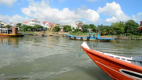 Tourist boats on the river in Hoi An, Vietnam. Ancient and peaceful, Hoi An is one of the most popular destinations in Vietnam that caters to travellers of all stock footage