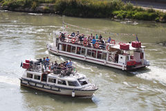 Tourist boats on River Tiber (Rome - Italy) Royalty Free Stock Images