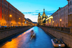 Tourist boats sail to the Church of Savior on Spilled Blood in S Stock Image